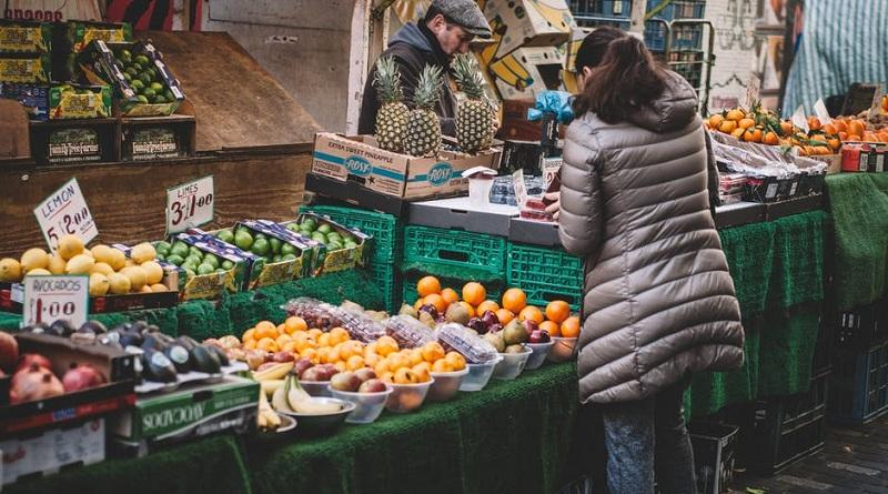 Image showing a woman looking at product to reduce food waste